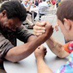 Watch a Heartwarming Twist Happen As 2 Homeless Guys Are Made to Arm-Wrestle for $100.