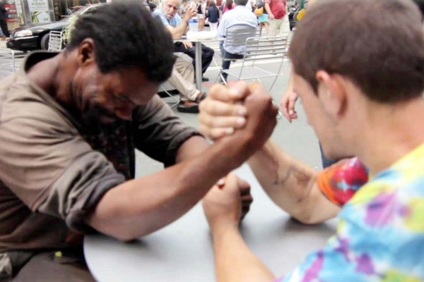 A Homeless Black Man Arm-Wrestles a Homeless White Man for $100. It Ends Wonderfully.